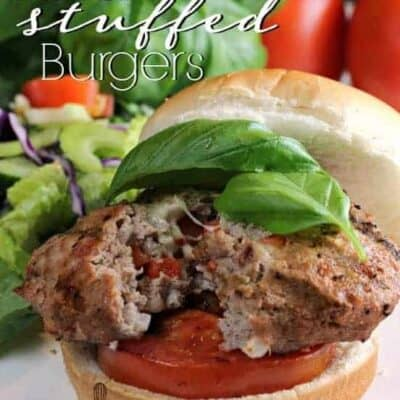 Italian Stuffed Turkey Burgers stuffed with cheese, pancetta and seasoning topped with grilled tomatoes and fresh basil