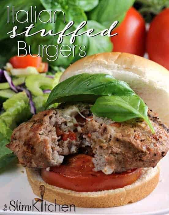 Italian Stuffed Turkey Burgers! Juicy turkey burgers stuffed with cheese, prosciutto and seasoning topped with grilled tomatoes and fresh basil! Delicious!