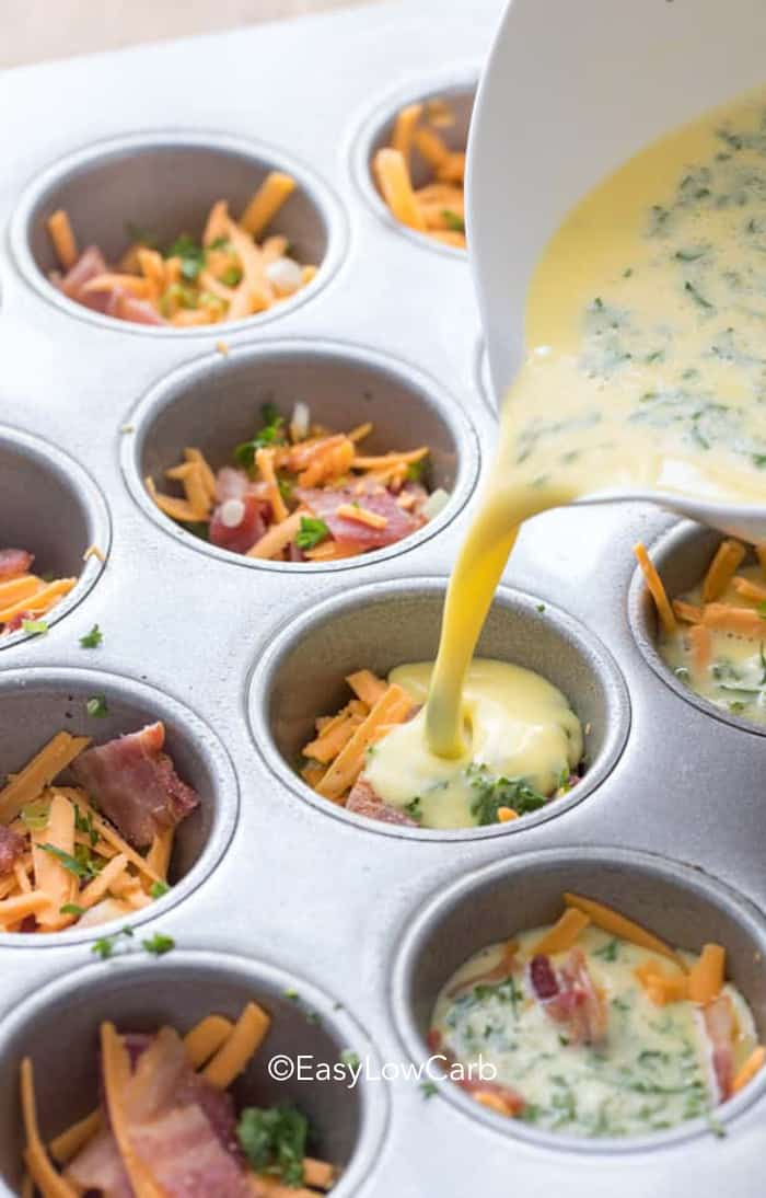 pouring eggs in tins for Bacon Egg Muffins