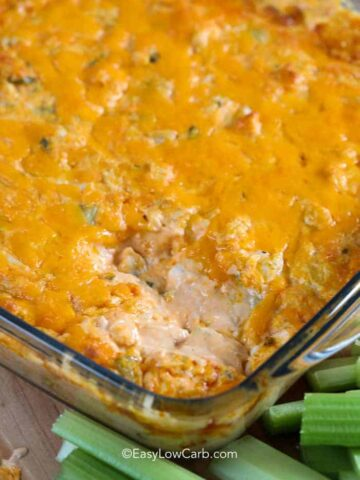 baked Buffalo Chicken Dip with a scoop out of it