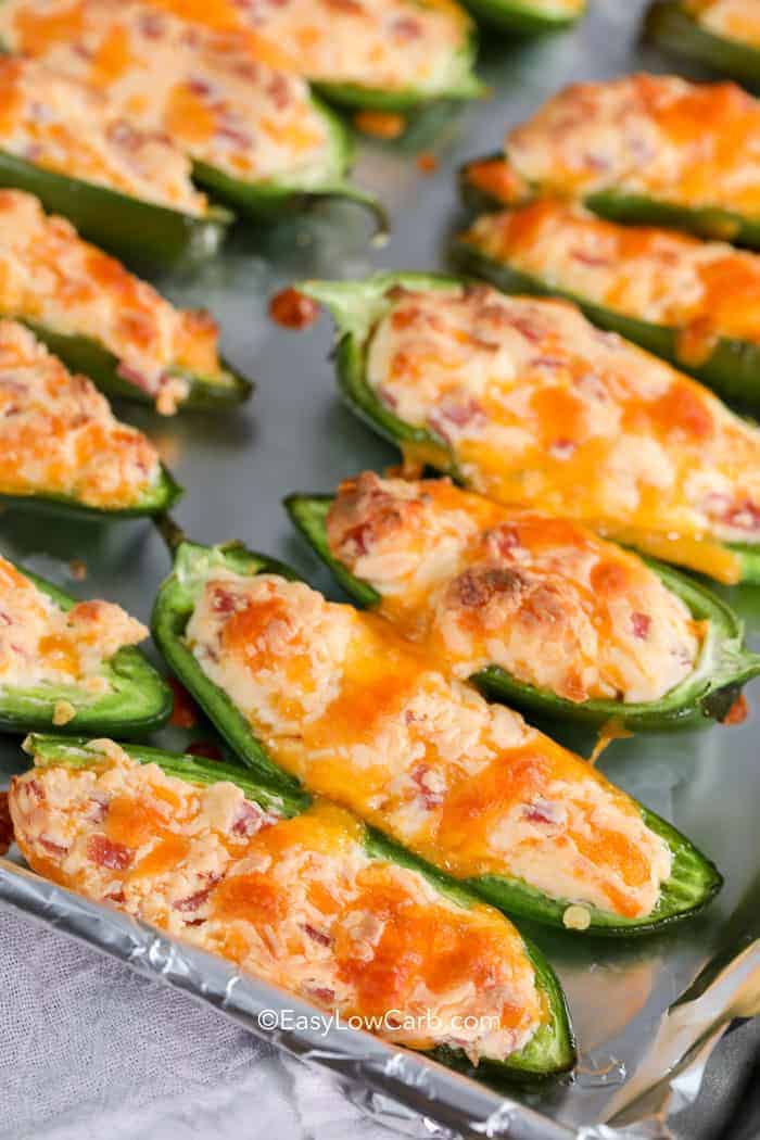Jalapeno poppers straight from the oven covered in melted cheese