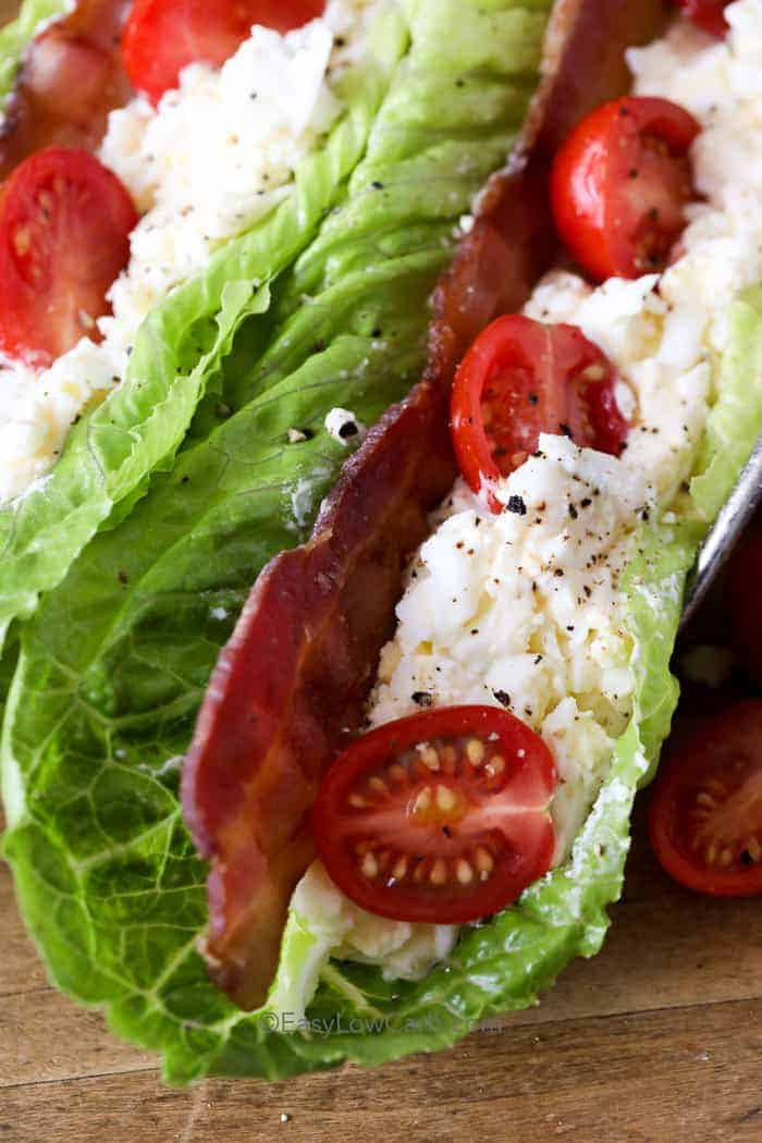 BLT Egg Salad Wraps topped with bacon and tomatoes