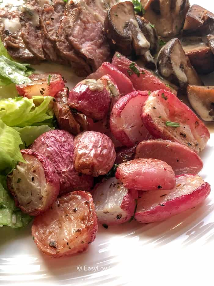 Tender roasted radishes on a plate