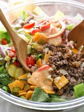 closeup of tossing Bacon Cheeseburger Salad