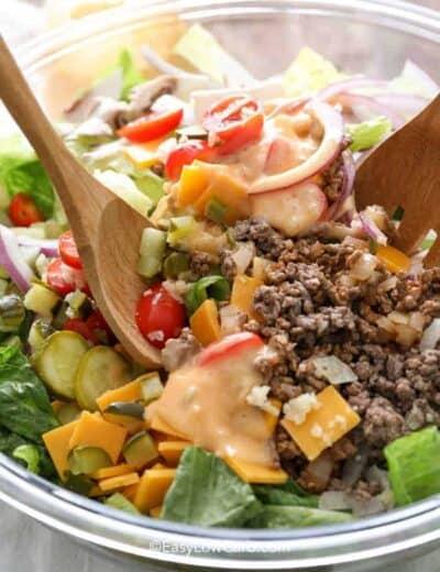 closeup of tossing Bacon Cheeseburger Salad