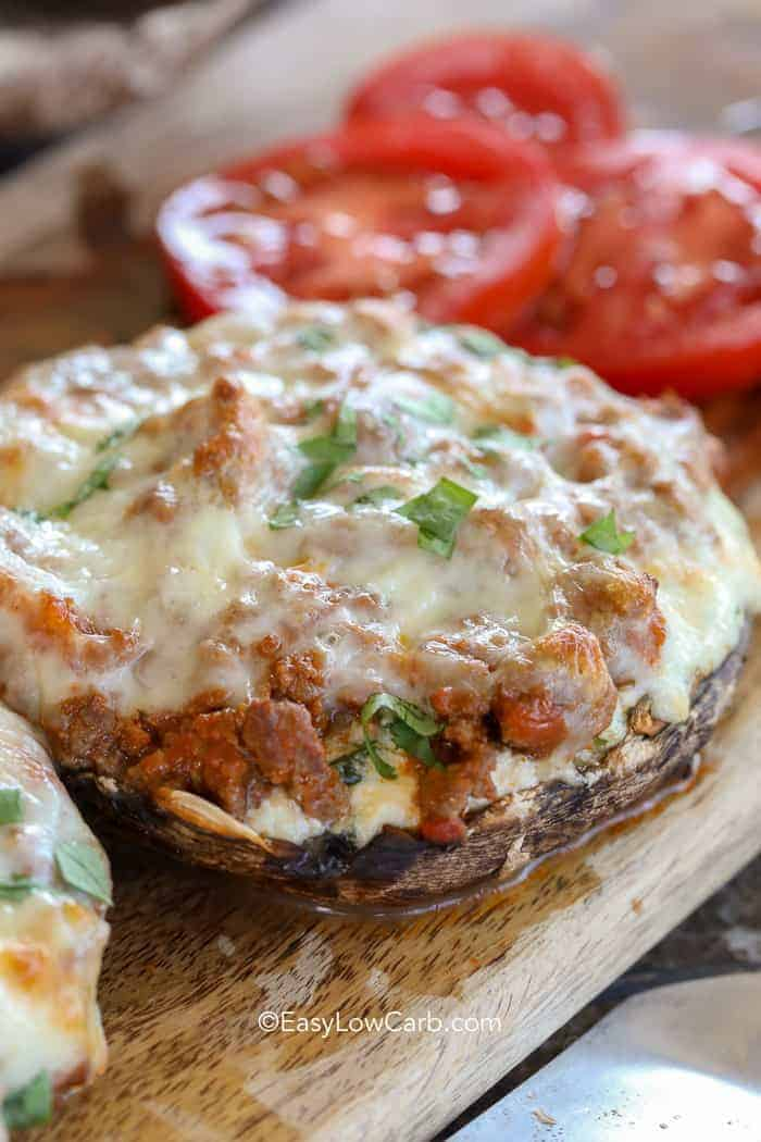 Juicy lasagna stuffed mushrooms covered in melting cheese and parsley fresh from the oven.