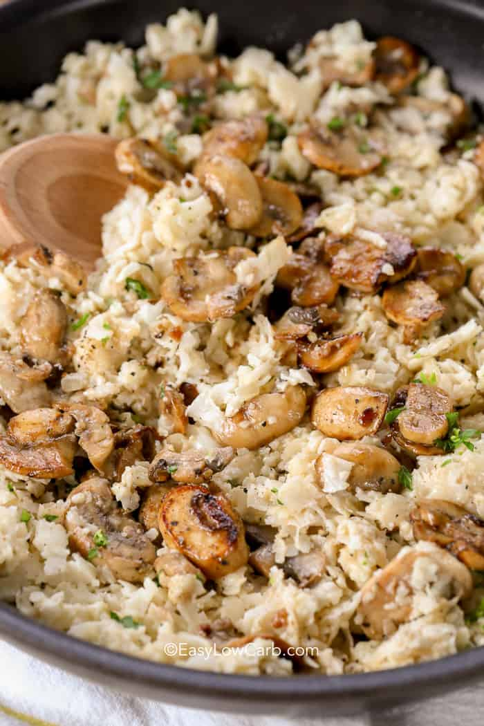 Rich and creamy cauliflower mushroom risotto in a saute pan.