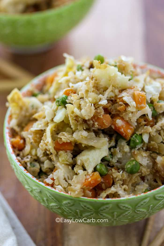 Cauliflower fried rice piled high in a green bowl.