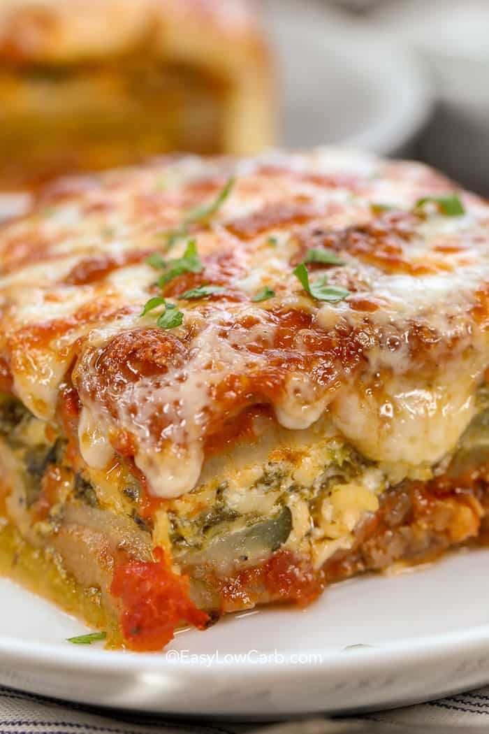 A slice of low carb zucchini lasagna on a a white plate