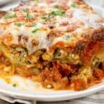 Easy Low Carb Zucchini Lasagna on a white plate, with a fork