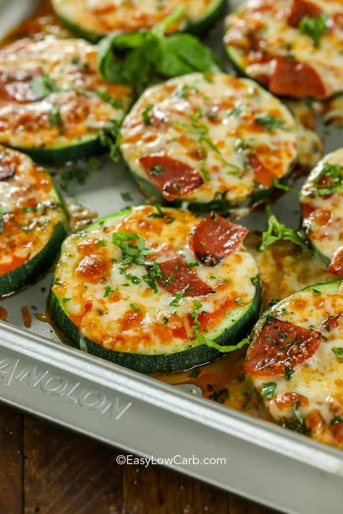 Zucchini Pizza bites hot and bubbly from the oven topped with fresh parsley.