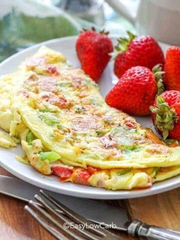 Denver Omlette on a plate with strawberries