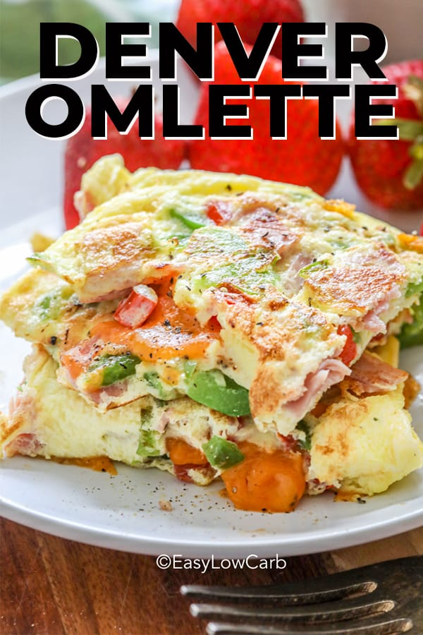 Slices of Denver omelet stacked on a plate with strawberries.