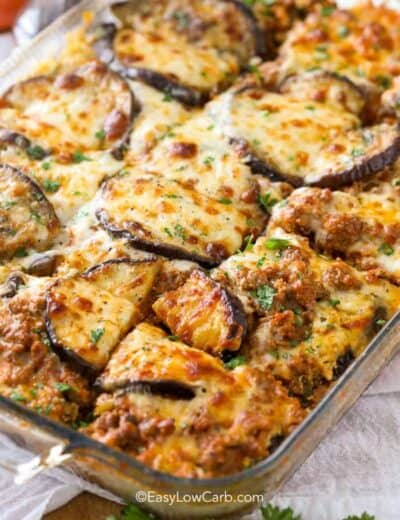 A clear baking dish with cooked Keto Eggplant Lasagna