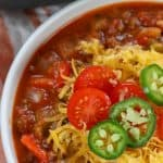 keto chili topped with jalapeños and cheese in a white bowl