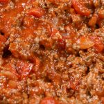 This easy low carb meat sauce recipe goes perfectly with just about anything. Serve it in lasagna, over zucchini noodles, pasta, or on bread. It is the ultimate healthy comfort food! #easylowcarb #meatsauce #tomatosauce #pastasauce #easymeatsauce