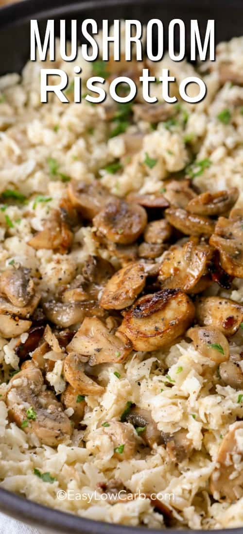 Cauliflower mushroom risotto topped with mushrooms on a white plate with pork tenderloin.
