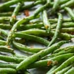 Roasted green beans are a low carb side dish perfect with just about any main. I could eat them on their own! #easylowcarb #greenbean #beans #greenbeans #roastedgreenbeans #sidedish