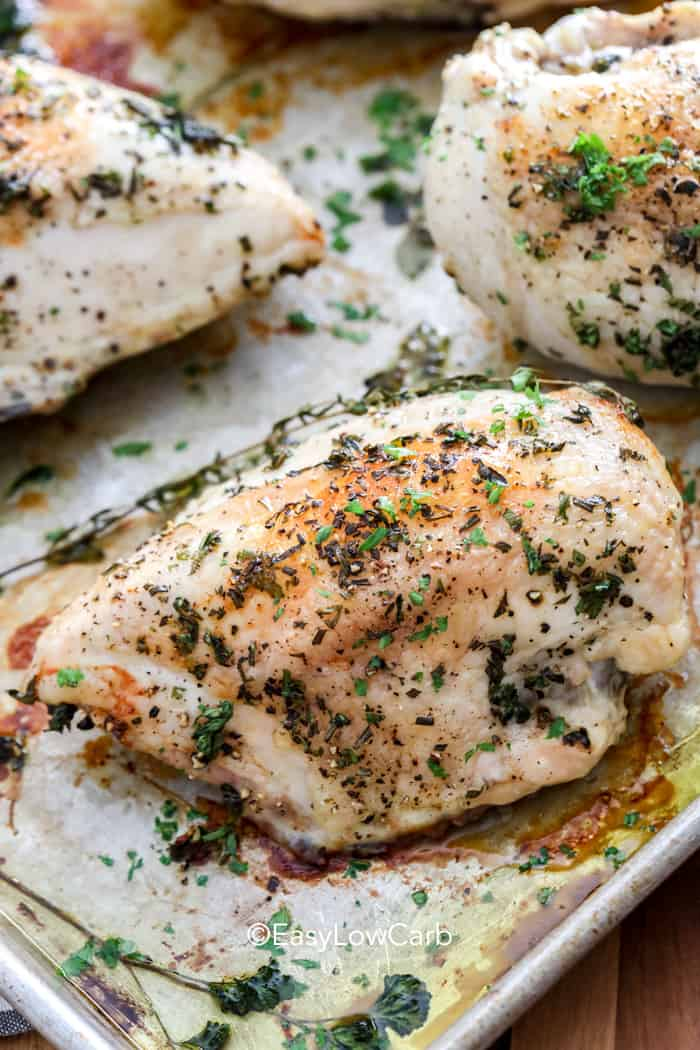 Baked Bone in Chicken Breast with herbs on a baking tray