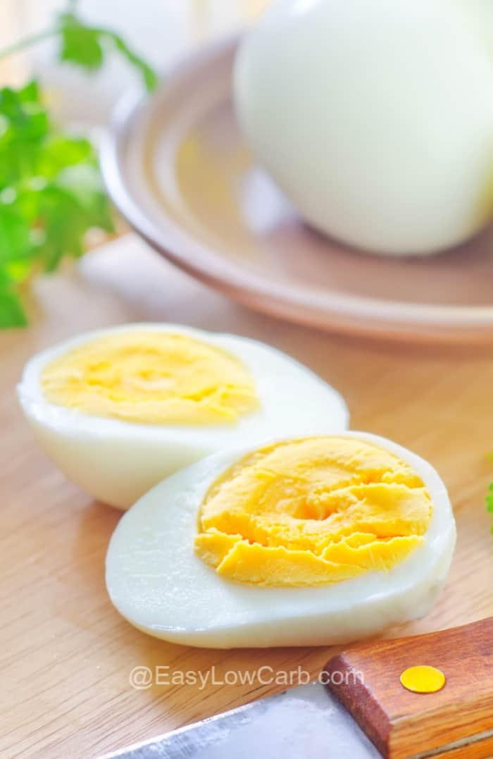 hard boiled egg halves on a wooden board