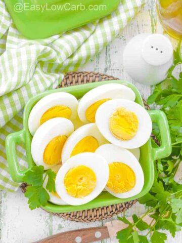 hard boiled egg halves in a green serving dish