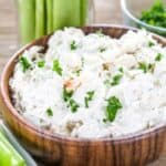 Low carb crab dip in a wood bowl with celery around