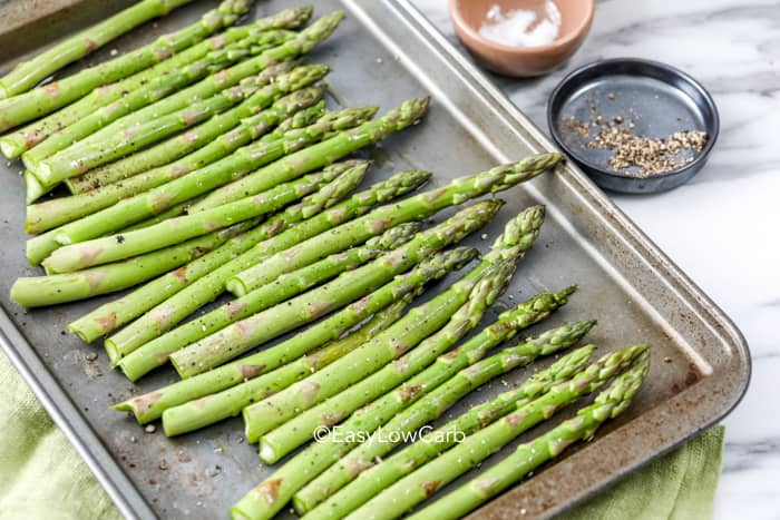 prepped asparagus on a pan for roasting