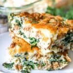 a slice of Spinach Cheese Egg Bake on a white plate