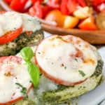 Pesto Chicken with tomatoes and cheese piece closeup