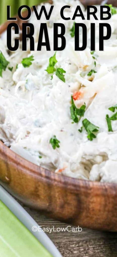 closeup of low carb crab dip with parsley in a wood bowl