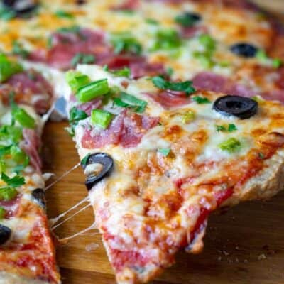 Chicken Pizza Crust topped with cheese, olives and green onion