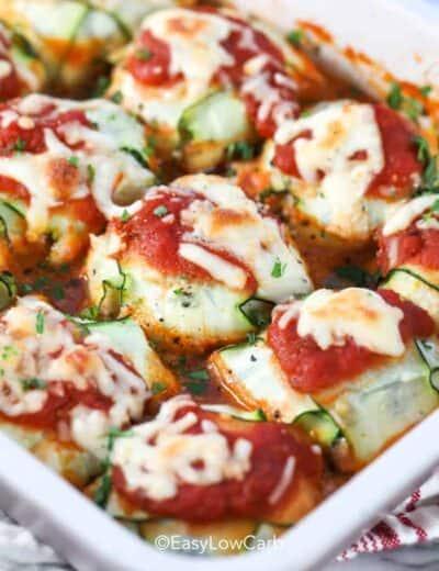 close up of zucchini ravioli baked in a white casserole dish