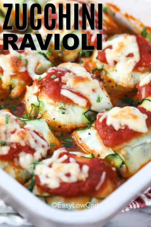 zucchini ravioli baked in a white casserole dish with text