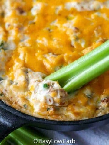 low carb Warm Bacon Dip in a skillet with celery dipper