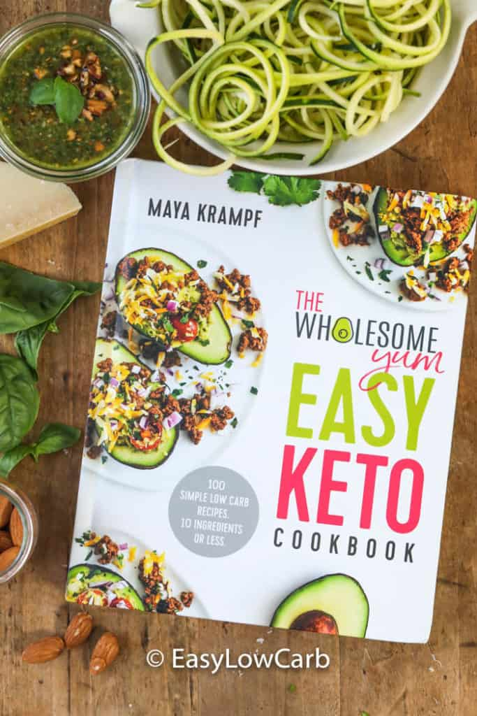 The Wholesome Yum Easy Keto Cookbook with zucchini noodles and almond pesto on the side