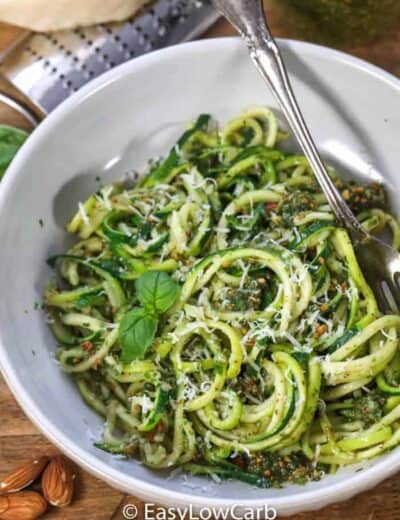 Almond Pesto Zoodles garnished with basil in a white dish