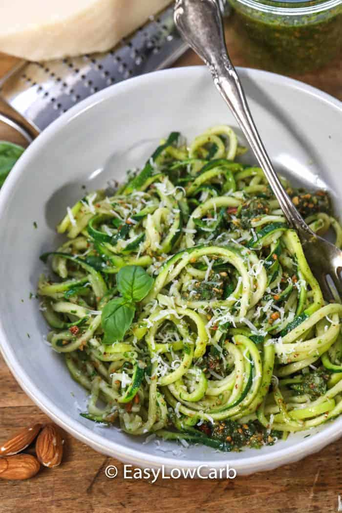 A serving of Zucchini Almond Pesto in a white bowl.