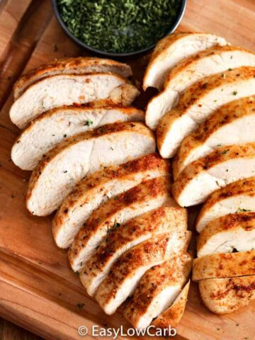 sliced Air Fryer Chicken Breasts on a wooden board