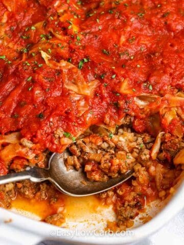 unstuffed cabbage casserole being served from a white baking dish