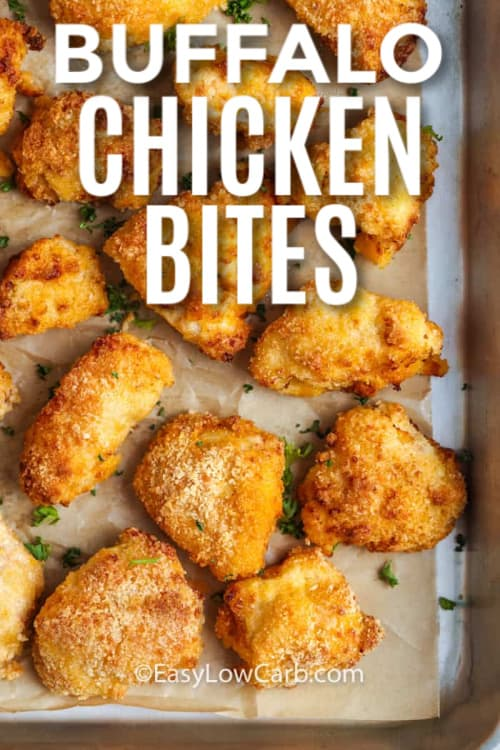 Buffalo Chicken Bites baked golden on a lined baking sheet with a title