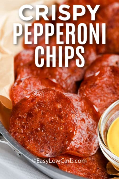 Pepperoni Chips piled in a dish with a side of mustard and a title.
