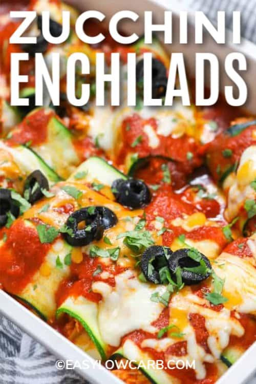 Zucchini Enchiladas in a white baking dish with writing.