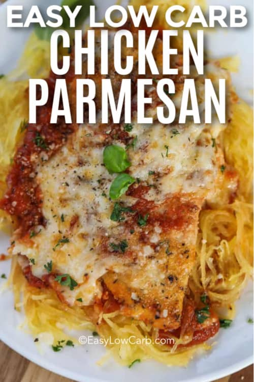 A serving of low carb chicken parmesan served over spaghetti squash on a white plate with writing