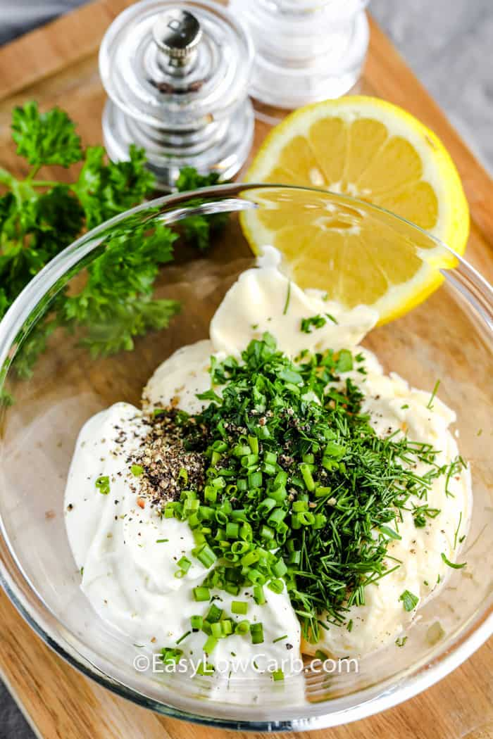ingredients to make Homemade Ranch in a glass bowl