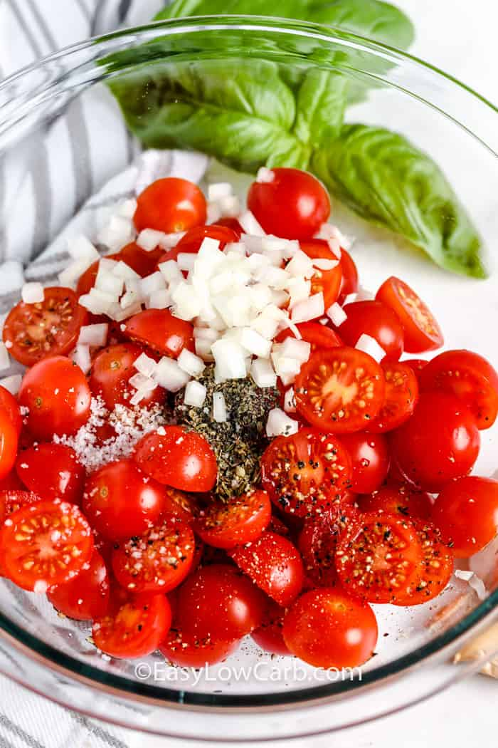 ingredients to make Tomato Salad in a glass bowl