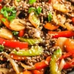 Easy Beef Stir Fry prepared in a pan, garnished with sesame seeds.