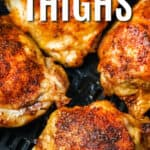 Air Fryer Chicken Thighs in an air fryer with writing