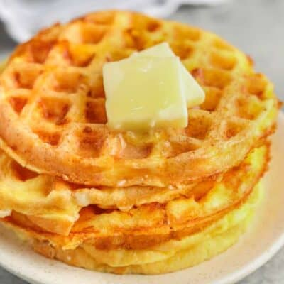 Basic Chaffle Recipe on a plate with butter on top