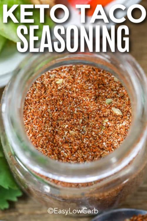 overhead of a glass jar of taco seasoning with a title