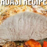 Oven Roasted Pork Loin Roast on a baking sheet with vegetables and writing.